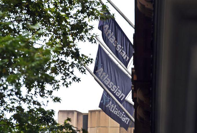 This photo taken on December 8, 2015 shows flags adorning the head office of Australian tech start-up Atlassian .