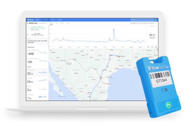 Tive tracker over computer displaying tracking data software.